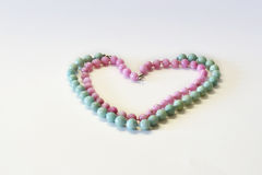 Heart from a beads from natural semiprecious stones on a white b Royalty Free Stock Photo
