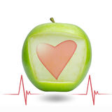 Heart beat with green apple Stock Images