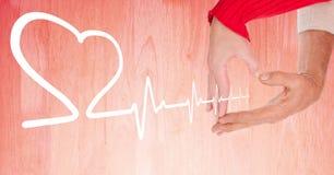 Heart beat over hands holding heart. Digital composite of Heart beat over hands holding heart royalty free stock photo