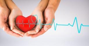 Heart beat over hands holding heart. Digital composite of Heart beat over hands holding heart stock photos