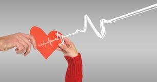 Heart beat over hands holding heart. Digital composite of Heart beat over hands holding heart stock photography
