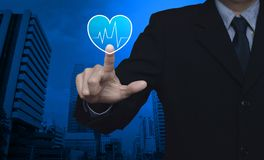 Business medical health care service concept. Heart beat pulse flat icon over modern office city tower, Business medical health care service concept stock photography