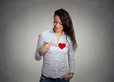 Heart beat. Woman drawing a heart on her shirt. Heart beat. Young woman drawing a heart on her shirt stock image