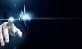 Heart beating rate. Male hand touch heart pulse on futuristic interface royalty free stock images