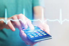 Heart beatment analysing with a smartphone app interface royalty free stock photos