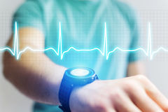 Heart beatment analysing with a smartwatch app interface stock images