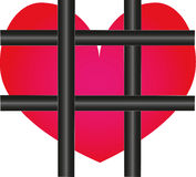 Heart behind the borders. Scarlet heart of the black metal bars grating Royalty Free Stock Images