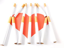 Heart behind cigarette bars. Royalty Free Stock Photo