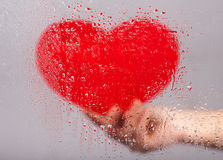 Heart behind the glass Royalty Free Stock Photo