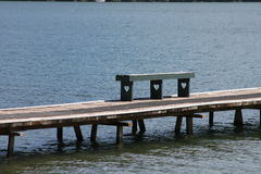 Heart bench on lake dock Royalty Free Stock Photo
