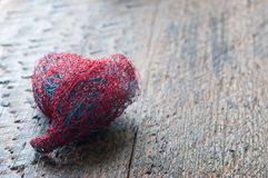 Heart. The heart of bent wire  on wood background Stock Image