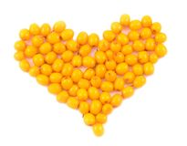 Heart from berries. Of sea-buckthorn berries to Valentine day sacred on  white background Stock Photo