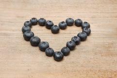 Heart of bilberries Stock Photo