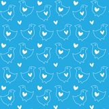 The heart and the birds. Seamless texture of white hearts and birds on a blue background Stock Photos
