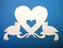 Heart with birds. Paper cutting. Stock Image
