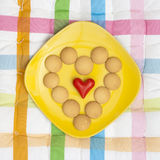 Heart of biscuits with small red heart Stock Photography