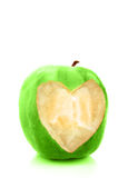 Heart bite. Apple with a heart shaped bite taken out. (healthy diet Stock Photos