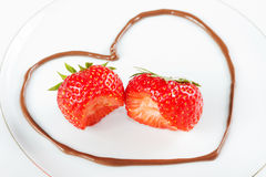 Heart with bitten into strawberries Stock Images