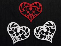 Heart on black background. White and black hearts on black background Stock Photography