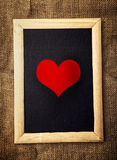 Heart on black board Royalty Free Stock Images