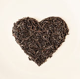 Heart of black loose tea from Ceylon, Valentine's day Royalty Free Stock Images