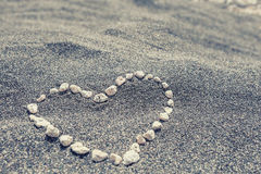 Heart on the black sand Royalty Free Stock Photos
