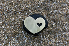 Heart on Black Stone on Sand Stock Photography
