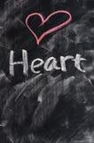Heart on blackboard Stock Photography