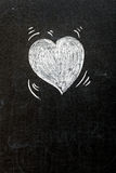 Heart on blackboard Stock Photo