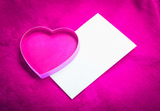 Heart with a blank card on red background Royalty Free Stock Photos