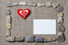 Heart and blank note card framed by stones Royalty Free Stock Photos