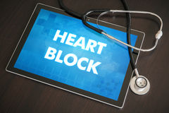 Heart block (heart disorder) diagnosis medical concept on tablet. Screen with stethoscope stock image