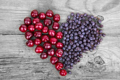 Heart from bluberry and cherry Royalty Free Stock Photos