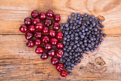 Heart from bluberry and cherry Royalty Free Stock Photography