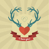 Heart with blue deer antlers. Stock Photo