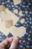 Heart blue floral background, hand holding a heart Stock Photo