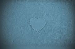 Heart on blue green vintage leather background Stock Photography