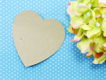 Heart on blue polka dot background and beautiful flower Stock Image