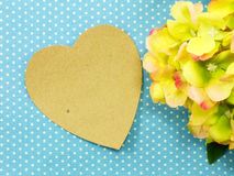 Heart on blue polka dot background and beautiful flower Stock Photo