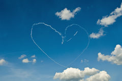 Heart On Blue Sky. Air Show White Smoke Heart On Blue Sky with White Clouds stock images