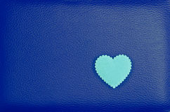 Heart on blue vintage leather background Royalty Free Stock Image