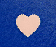 Heart on blue vintage leather background Royalty Free Stock Photo