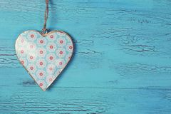 Heart on a wooden background. Heart on a blue wooden background royalty free stock photo