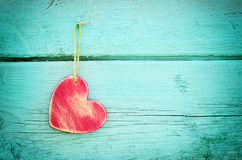 Heart on a blue wooden background Stock Photos