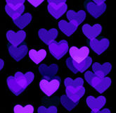 Heart bokeh background, photo blurry objects, blue on black Royalty Free Stock Photo