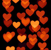 Heart bokeh background, photo blurry objects, brown red on black Stock Photo