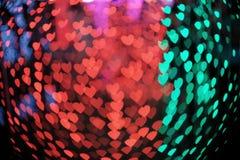 Heart bokeh background. Bokeh heart taken at night Stock Image
