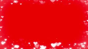 Heart bokeh frame on the red background stock footage