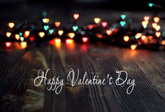 Heart bokeh, Valentine`s day concept on wooden background Royalty Free Stock Image
