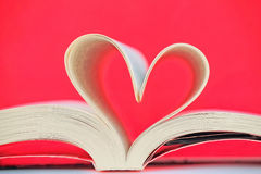 Heart on the book Stock Photos